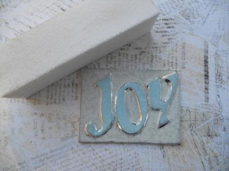 Joy tag sanding